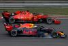 SHANGHAI, CHINA - APRIL 14: Max Verstappen of the Netherlands driving the (33) Aston Martin Red Bull Racing RB15 and Sebastian Vettel of Germany driving the (5) Scuderia Ferrari SF90 battle for position during the F1 Grand Prix of China at Shanghai International Circuit on April 14, 2019 in Shanghai, China. (Photo by Charles Coates/Getty Images)