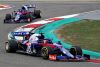 SHANGHAI, CHINA - APRIL 14: Daniil Kvyat of Russia driving the (26) Scuderia Toro Rosso STR14 Honda leads Alexander Albon of Thailand driving the (23) Scuderia Toro Rosso STR14 Honda on track during the F1 Grand Prix of China at Shanghai International Circuit on April 14, 2019 in Shanghai, China. (Photo by Mark Thompson/Getty Images)
