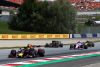 SPIELBERG, AUSTRIA - JUNE 30: Pierre Gasly of France driving the (10) Aston Martin Red Bull Racing RB15 leads Kevin Magnussen of Denmark driving the (20) Haas F1 Team VF-19 Ferrari, Sergio Perez of Mexico driving the (11) Racing Point RP19 Mercedes and Daniel Ricciardo of Australia driving the (3) Renault Sport Formula One Team RS19 on track during the F1 Grand Prix of Austria at Red Bull Ring on June 30, 2019 in Spielberg, Austria. (Photo by Lars Baron/Getty Images)