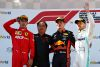 SPIELBERG, AUSTRIA - JUNE 30: Top three finishers Max Verstappen of Netherlands and Red Bull Racing, Charles Leclerc of Monaco and Ferrari and Valtteri Bottas of Finland and Mercedes GP celebrate on the podium with Toyoharu Tanabe of Honda during the F1 Grand Prix of Austria at Red Bull Ring on June 30, 2019 in Spielberg, Austria. (Photo by Mark Thompson/Getty Images)