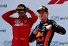 SPIELBERG, AUSTRIA - JUNE 30: Race winner Max Verstappen of Netherlands and Red Bull Racing celebrates on the podium as second placed Charles Leclerc of Monaco and Ferrari looks dejected during the F1 Grand Prix of Austria at Red Bull Ring on June 30, 2019 in Spielberg, Austria. (Photo by Mark Thompson/Getty Images)
