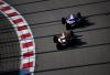SOCHI, RUSSIA - SEPTEMBER 29: Pierre Gasly of France driving the (10) Scuderia Toro Rosso STR14 Honda and Alexander Albon of Thailand driving the (23) Aston Martin Red Bull Racing RB15 on track during the F1 Grand Prix of Russia at Sochi Autodrom on September 29, 2019 in Sochi, Russia. (Photo by Clive Mason/Getty Images)