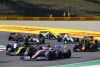 Sergio Perez, Racing Point RP20, leads Daniel Ricciardo, Renault R.S.20, Alexander Albon, Red Bull Racing RB16, Daniil Kvyat, AlphaTauri AT01, and the remainder of the field at the restart